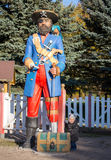 Little boy and giant one legged pirate. In the park Royalty Free Stock Photo