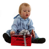 Little boy with a gift. Little boy sits with a gift isolated on a white Royalty Free Stock Photo