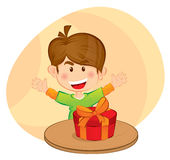 Little boy with a gift. A little boy looked happy with a gift on the table Royalty Free Stock Photos