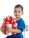 The little boy with a gift. The little boy is disappointed by a small gift Stock Photography