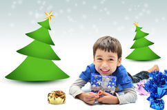 Little boy with gift for chrismas and new year Stock Image