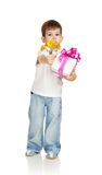 The little boy with a gift and the colors Royalty Free Stock Images