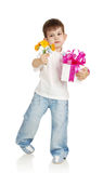 The little boy with a gift and the colors Stock Photos