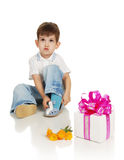 The little boy with a gift and the colors Stock Image