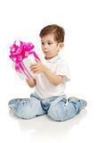 The little boy with a gift in a hands Stock Photo