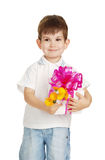 The little boy with a gift in a hands Royalty Free Stock Image