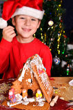 Little boy with a gingerbread house Royalty Free Stock Photos