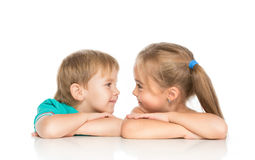 Little boy and girl. Lovingly look at each other Royalty Free Stock Photography