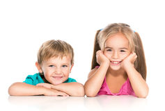 Little boy and girl. A little boy and girl laughing isolated on a white Stock Photos