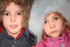 Little boy and girl in big fur hoods Stock Photography
