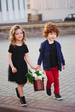Little boy and girl with big lilac bouquet Stock Photos