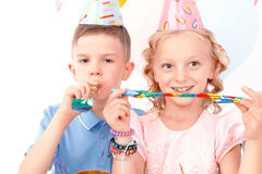 Little boy and girl during birthday party Stock Images