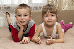 Little boy and girl brother and sister playing together with sma Stock Photos