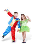 Little boy and girl in carnival suits stand Stock Photos