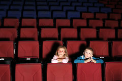 Little boy and girl in  cinema hall Stock Image
