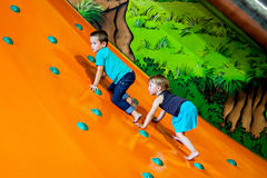Little boy and girl climbing Royalty Free Stock Images