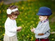 Little boy and girl with dandelions Stock Images