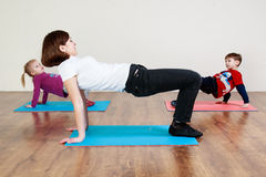 A little boy and a girl are doing an exercise stock photography