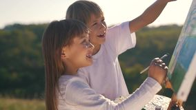 Little boy and girl draw the picture.  stock footage