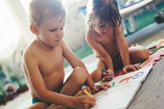 Little boy and girl drawing with crayons Royalty Free Stock Photography