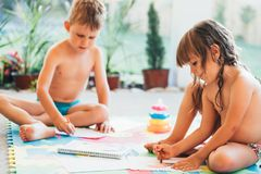 Little boy and girl drawing with crayons Royalty Free Stock Photos
