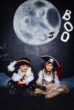 Boy and girl in pirate costumes. Halloween Concept Stock Image