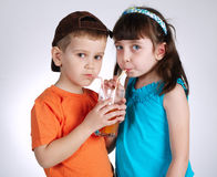Little boy and girl drinking juice Royalty Free Stock Images