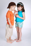 Little boy and girl drinking juice Royalty Free Stock Photography