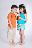 Little boy and girl drinking juice Royalty Free Stock Photos