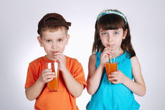 Little boy and girl drinking juice Stock Photo