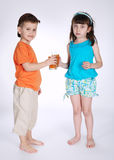 Little boy and girl drinking juice Royalty Free Stock Image