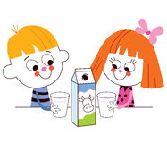 Little boy and girl drinking milk Royalty Free Stock Image