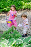 Little Boy and Girl on an Easter Egg Hunt Stock Photo