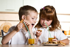 Little boy and girl eat cookies Stock Images