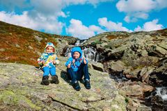 Little boy and girl enjoy travel in nature at waterfall. Little boy and girl enjoy travel hiking in nature at waterfall, family travel royalty free stock photo