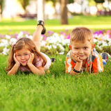 Little boy and girl among flowers. Royalty Free Stock Photos