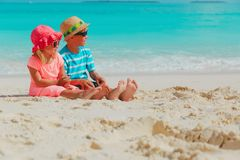 Little boy and girl having fun on beach royalty free stock photos