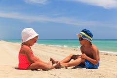 Little boy and girl having fun on beach Stock Photography
