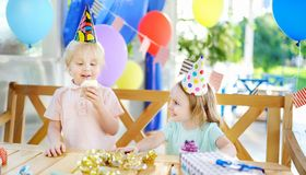 Little boy and girl having fun and celebrate birthday party with stock images