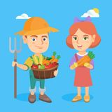 Little boy and girl holding fruit and vegetables. Royalty Free Stock Photo