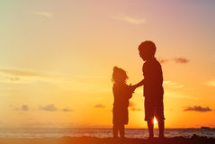 Little boy and girl holding hands at sunset Stock Photography