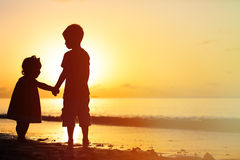 Little boy and girl holding hands at sunset Royalty Free Stock Photography