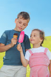 Little boy and girl holding ice-creams Royalty Free Stock Photo