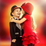 Little boy and girl hugging. Portrait of funny little boy and a cute girl hugging. Love concept Stock Photo