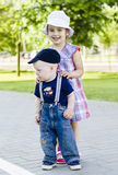 Little boy and girl hugging. Two happy kids,  little boy and girl hugging and smiling Royalty Free Stock Photos