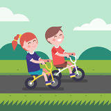 Little boy and girl kids riding bicycle Royalty Free Stock Photos