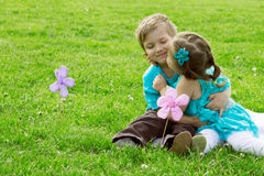 Little boy and girl kissing in green grass Stock Image