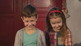 Little boy and girl laughing stock video