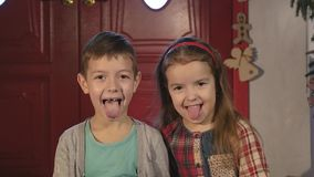 A little boy and girl laughing and hamming on camera stock footage