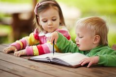 Little boy and girl learning to write Royalty Free Stock Photo